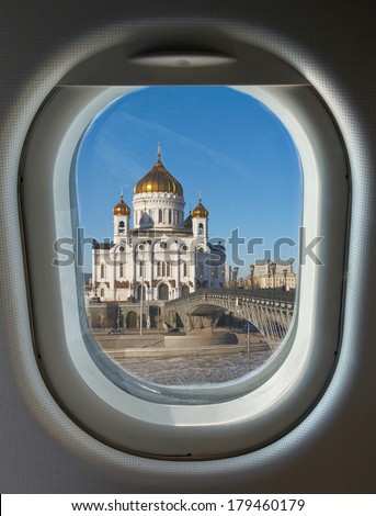 porthole and landmark, Christ the Saviour Cathedral in Moscow against the backdrop of a frozen river - stock photo