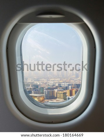 porthole and landmark, Dubai's skyscrapers and top view on a sunny day - stock photo