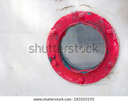 Porthole in old wooden ship's door  - stock photo