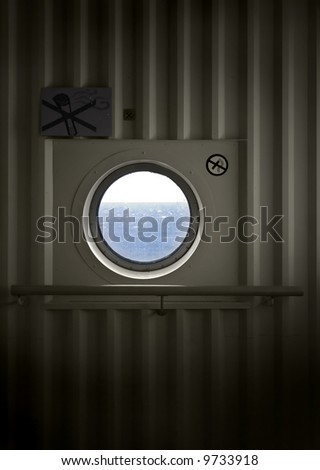 Porthole on ship wall - stock photo