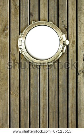 Porthole on the wooden background at pirate ship. Ship porthole as a circle frame, isolated on white.  Ship window on the old nautical vessel. - stock photo