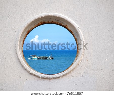 Porthole view of a Chinese fishing boat on the East China Sea - stock photo