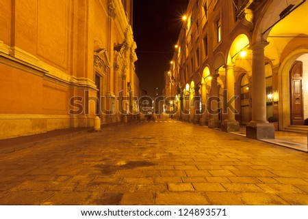portico and facade of st peter cathedral on via Altabella in Bologna, Italy at night - stock photo