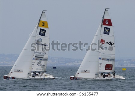 PORTIMAO, PORTUGAL - JUNE 23: Participant in action at World Match Racing Tour Cup -  June 23, 2010 in Portimao, Portugal. - stock photo