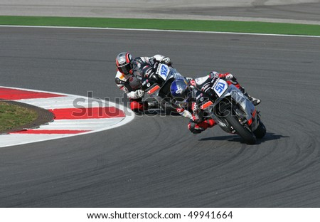 PORTIMAO, PORTUGAL - MARCH 27: Eugene Laverty (50) and Miguel Praia (117), Supersports on Superbikes, Algarve, Portimao on March 27, 2010. - stock photo