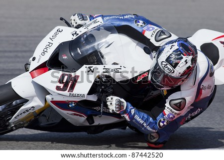 PORTIMAO, PORTUGAL - OCTOBER 16: A closeup of Leon Haslam, the fifth place winner of World Superbikes Championship,  in Algarve, Portimao on October 16, 2011. - stock photo