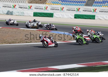 PORTIMAO, PORTUGAL - OCTOBER 16: The last race of 2011 Superbilkes championship with Carlos Checa leadering the group in Algarve, Portimao on October 16, 2011. - stock photo