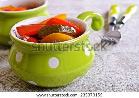 Portion is cut and cooked peppers and zucchini - stock photo