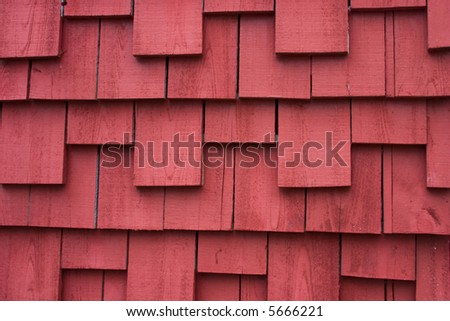 portion of a old house exterior covered with shake siding - stock photo