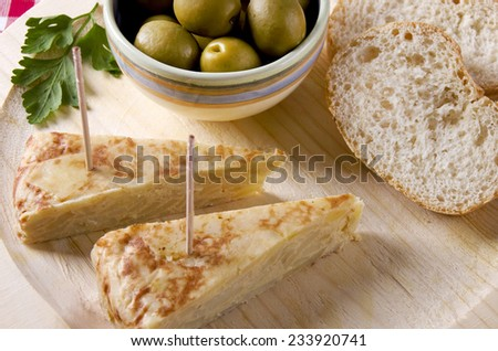 "Portion of a spanish potato omelet called ""tapa"" or ""pincho"", typical spanish pub food, - stock photo"
