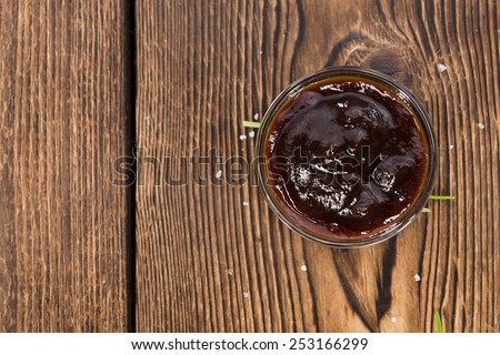 Portion of Barbeque Sauce (close-up shot) on dark rustic background