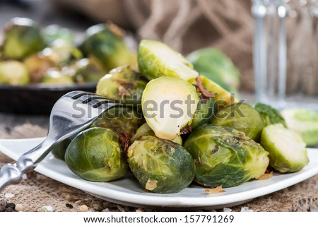 Portion of Brussel Sprouts with Ham and onions - stock photo