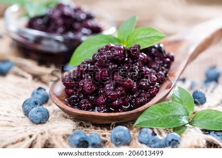 Portion of canned Blueberries with some fresh fruits