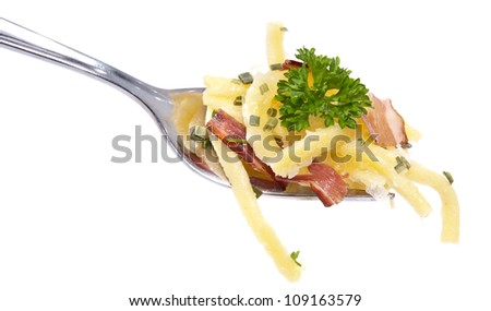 Portion of Cheese Spaetzle on a fork isolated on white background - stock photo