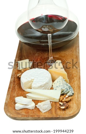 portion of cheeses and glass red wine on wooden board isolated on white background - stock photo
