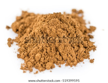 Portion of Cinnamon (as close-up shot) isolated on white background