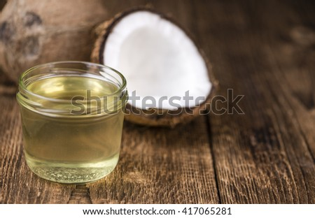 Portion of Coconut Oil (selective focus) on a wooden table - stock photo