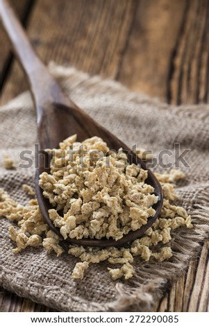 Portion of dried Soy Meat (close-up shot) on wooden background - stock photo