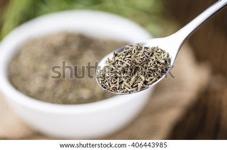Portion of dried Thyme (close-up shot; selective focus) on rustic background