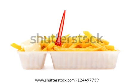 Portion of French fries with mayonnaise and plastic fork in disposable tray - stock photo