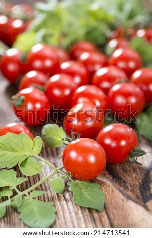 Portion of fresh Cherry Tomatoes on dark wooden background - stock photo