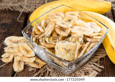 Portion of fresh dried Banana Chips (healthy food) - stock photo