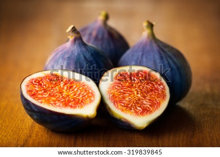 Portion of fresh figs on vintage background - stock photo