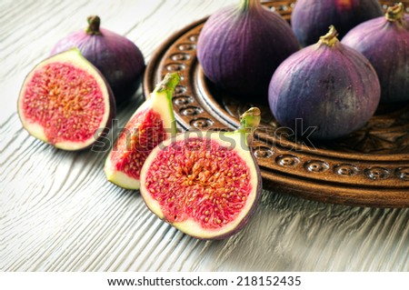 Portion of fresh Figs on wooden background - stock photo