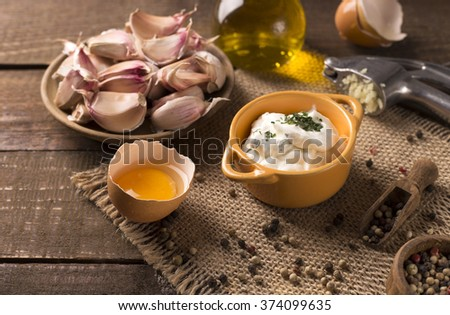 Portion of fresh homemade Aioli dip with ingredients - stock photo