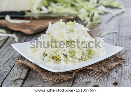Portion of fresh made Coleslaw on vintage wooden background - stock photo