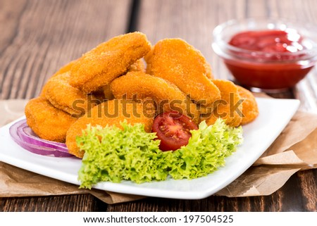 Portion of fresh made crispy chicken nuggets with tomato ketchup - stock photo