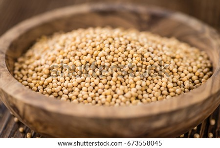 Portion of fresh made Mustard Seeds (close-up shot; selective focus)