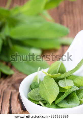 Portion of fresh Sage (detailed close-up shot) on wooden background - stock photo