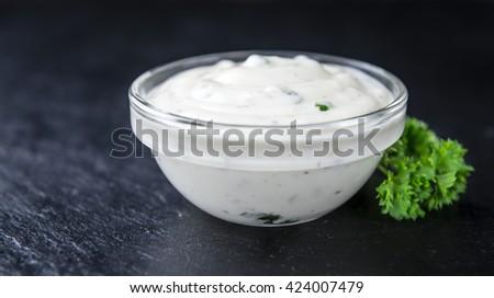 Portion of Garlic Sauce on a slate slab (selective focus; close-up shot) - stock photo