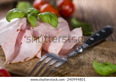 Portion of Ham with fresh herbs (close-up shot) - stock photo