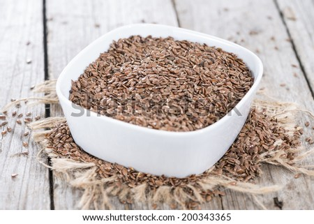 Portion of healthy brown Linseeds (detailed close-up shot) - stock photo