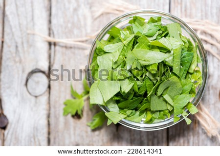 Portion of Lovage (fresh cutted leaves) as detailed close-up shot - stock photo