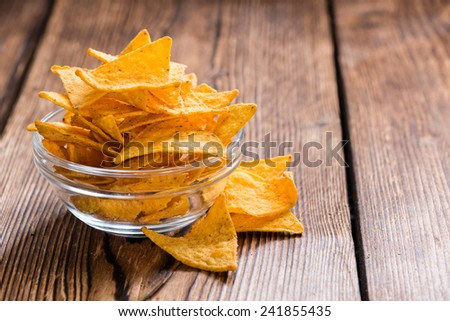 Portion of Nachos on rustic wooden background - stock photo