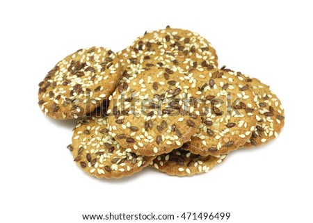 portion of oatmeal cookies with sesame seeds on a white background
