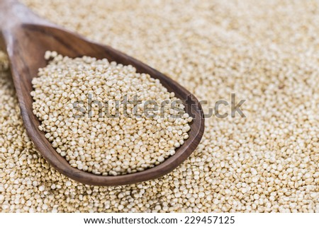 Portion of Quinoa (close-up shot) on a wooden spoon)