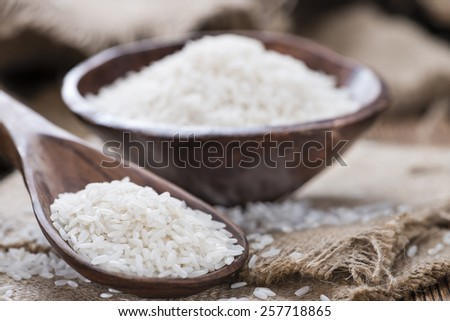 Portion of Rice (close-up shot) on rustic wooden background)