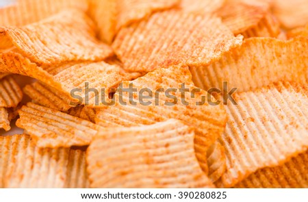 Portion of rippled Potato Chips for use as background image or as texture - stock photo