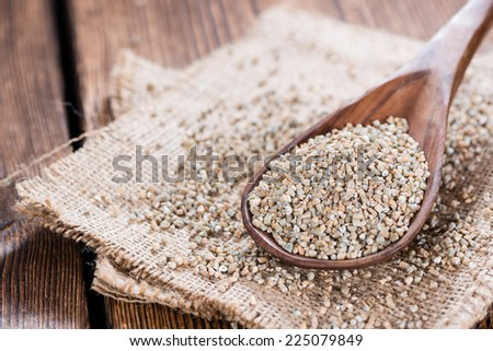 Portion of Rye Meal (close-up shot) on wooden background