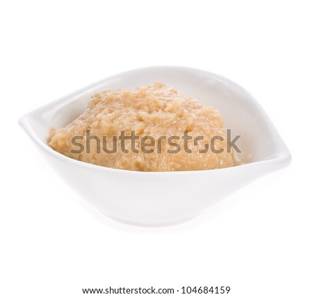 portion of sauce  horseradish  in a white bowl, isolated on white background - stock photo