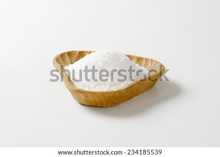 portion of sea salt in the handmade wooden bowl - stock photo