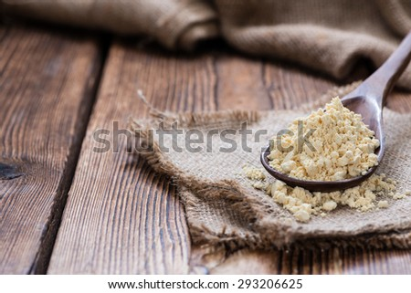 Portion of Soy Flour on dark rustic wooden background - stock photo
