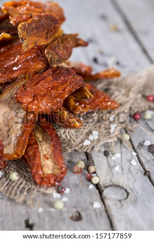 Portion of Sun Dried Tomatoes on wooden background