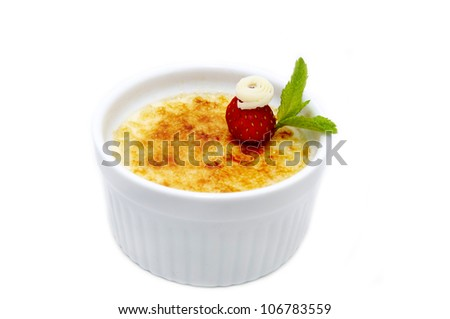 portion of the cream brulee on a white background - stock photo