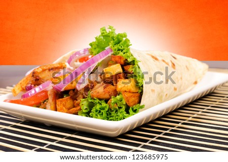 Portion of the gyros pita on the plate - stock photo