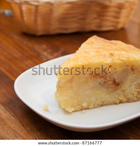 portion of tortilla (Spanish omelette) on a wooden table